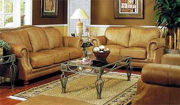 100 Leather Sofa Clic Frame In A Caramel Colored Accented Beautifully With Individual Placed Nail Heads Welcomed Addition To Any Home